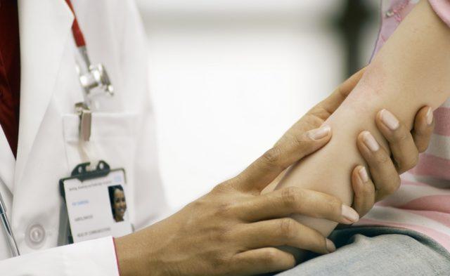 Doctor examines rash