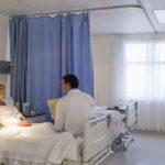 patient doctor speaking in hospital room