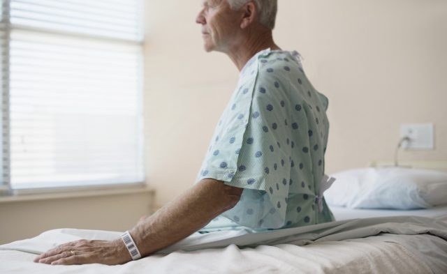man sitting on a hospital bed