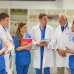 Physician talking with students