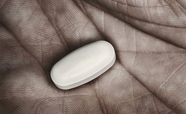 pill in man's hand