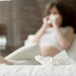 Young pregnant woman with flu
