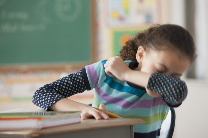 Child sneezing, pediatric illness