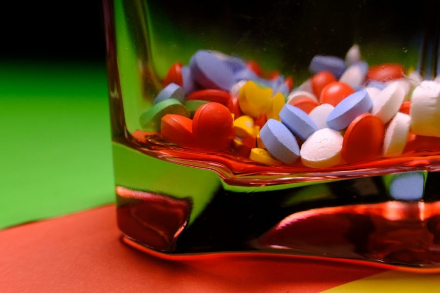 Mixed pills in glass container