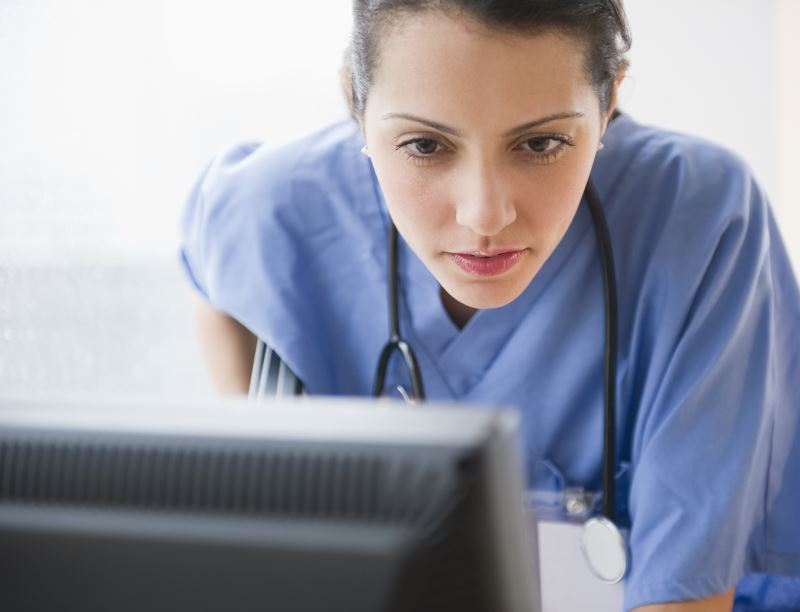 A physician using a computer