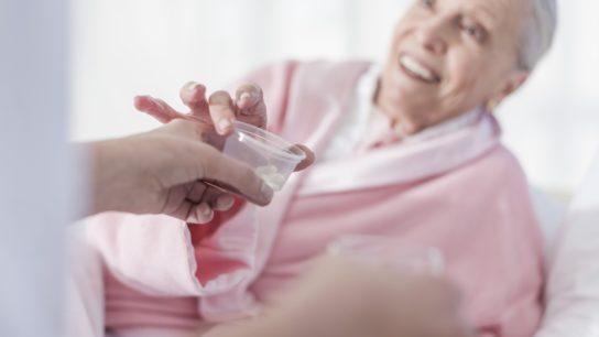 senior patient receiving medication