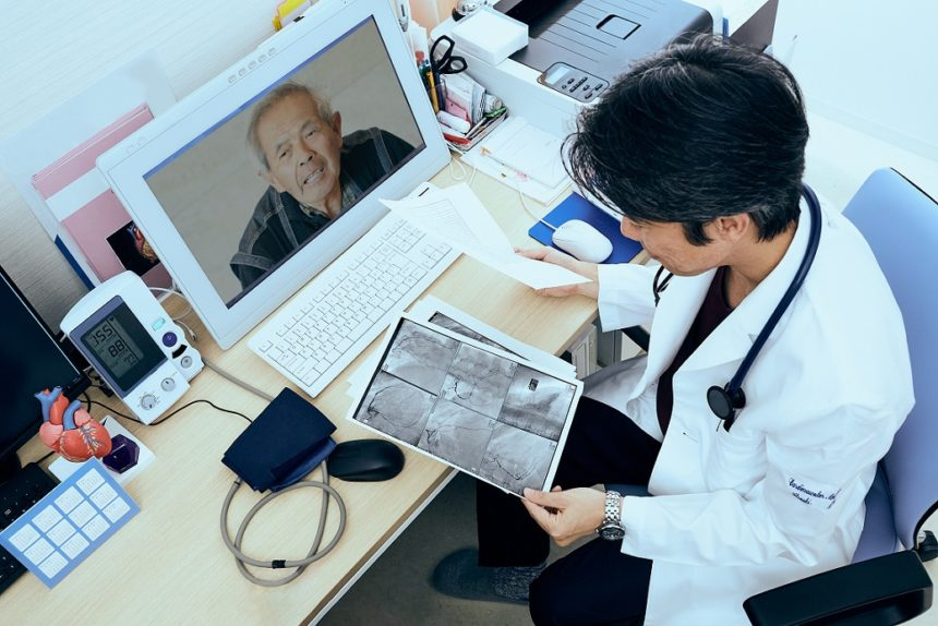 Telemedicine doctor looking at x-ray